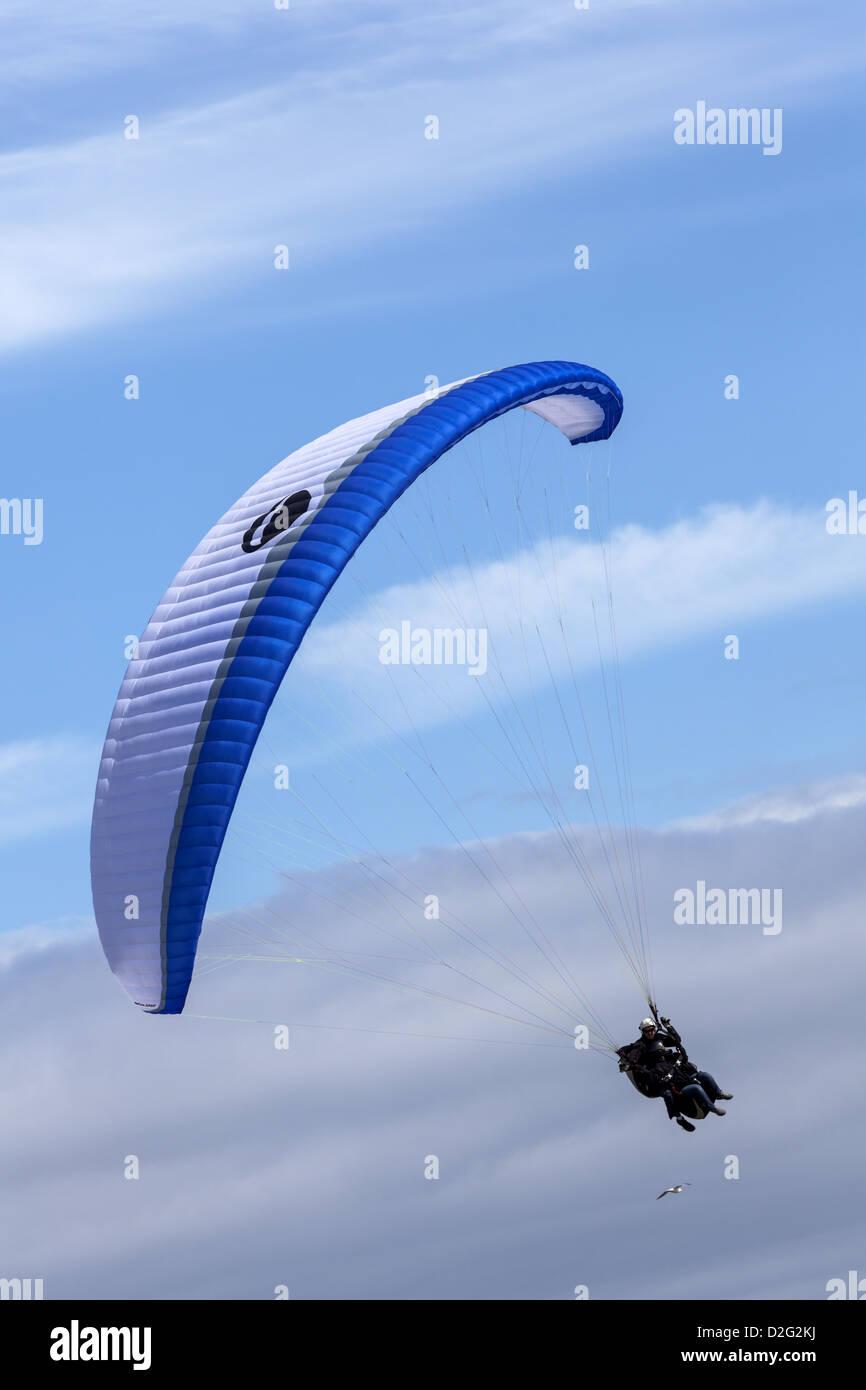A BiGolden 2 (tandem) paraglider soars - Stock Image