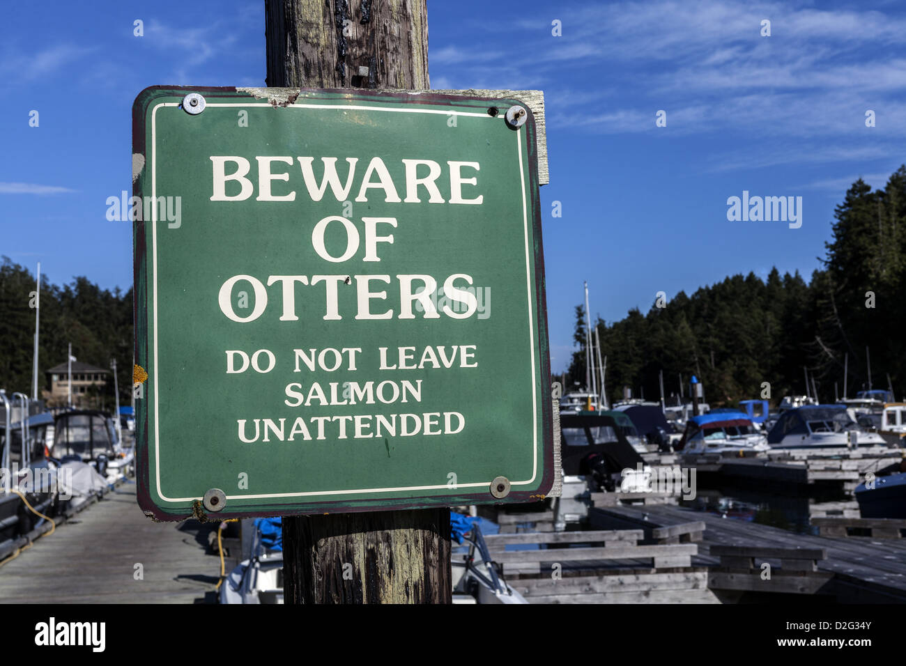 Beware of otters notice on the entrance of dock at Pedder Bay RV Resort and Marina near Metchosin Vancouver Island, - Stock Image