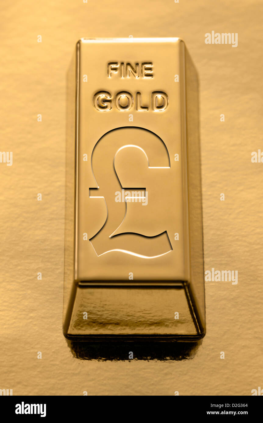 Gold Bar with a Sterling Pound symbol embossed on it on a gold background - Stock Image