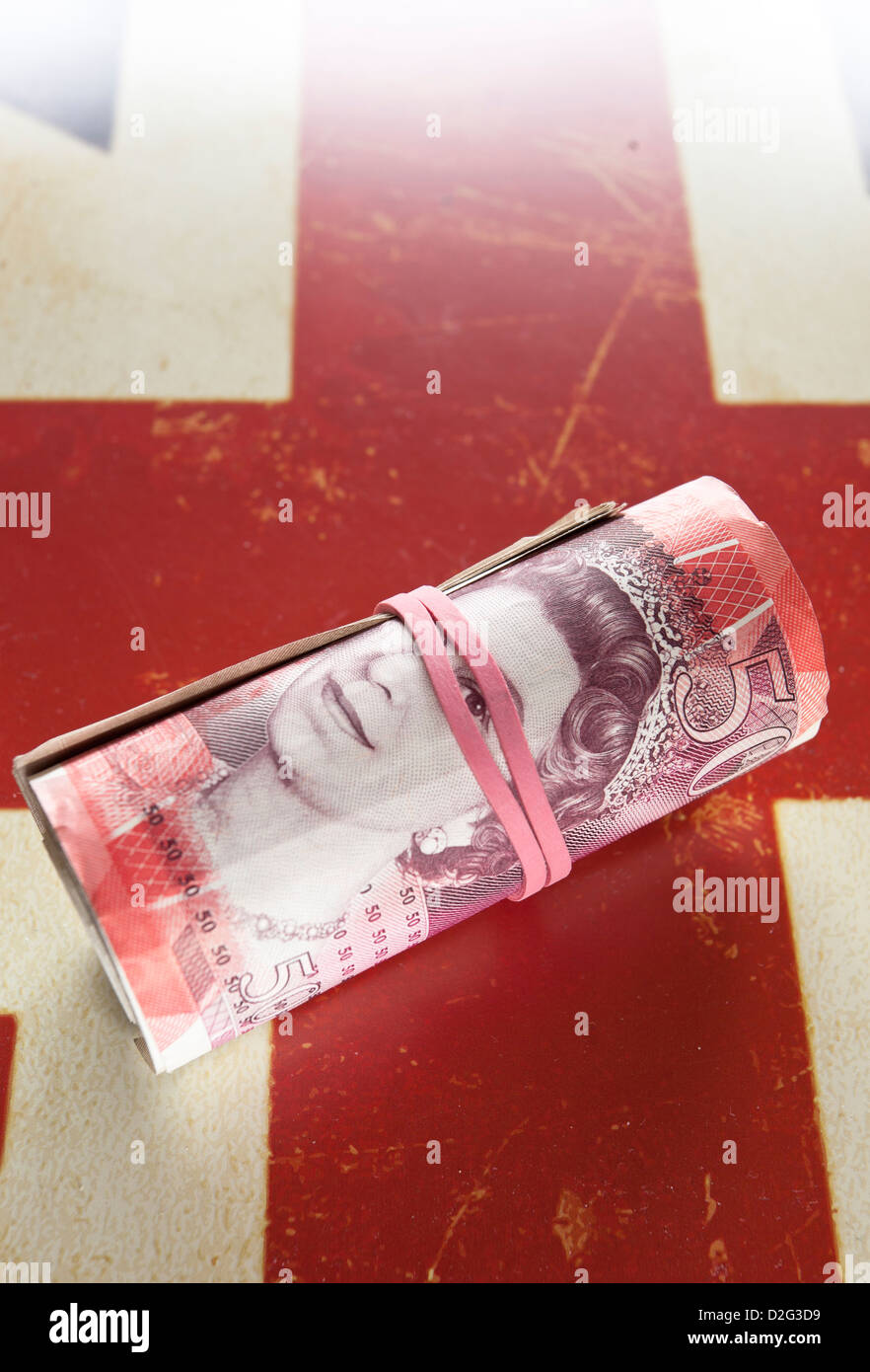 Fifty pounds sterling banknote roll. - Stock Image
