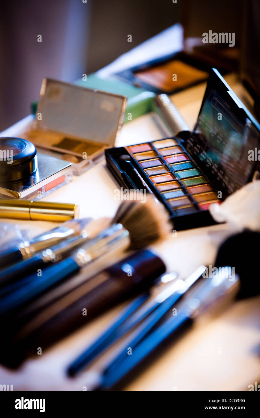 Photo of make up brushes and make up on a table - Stock Image