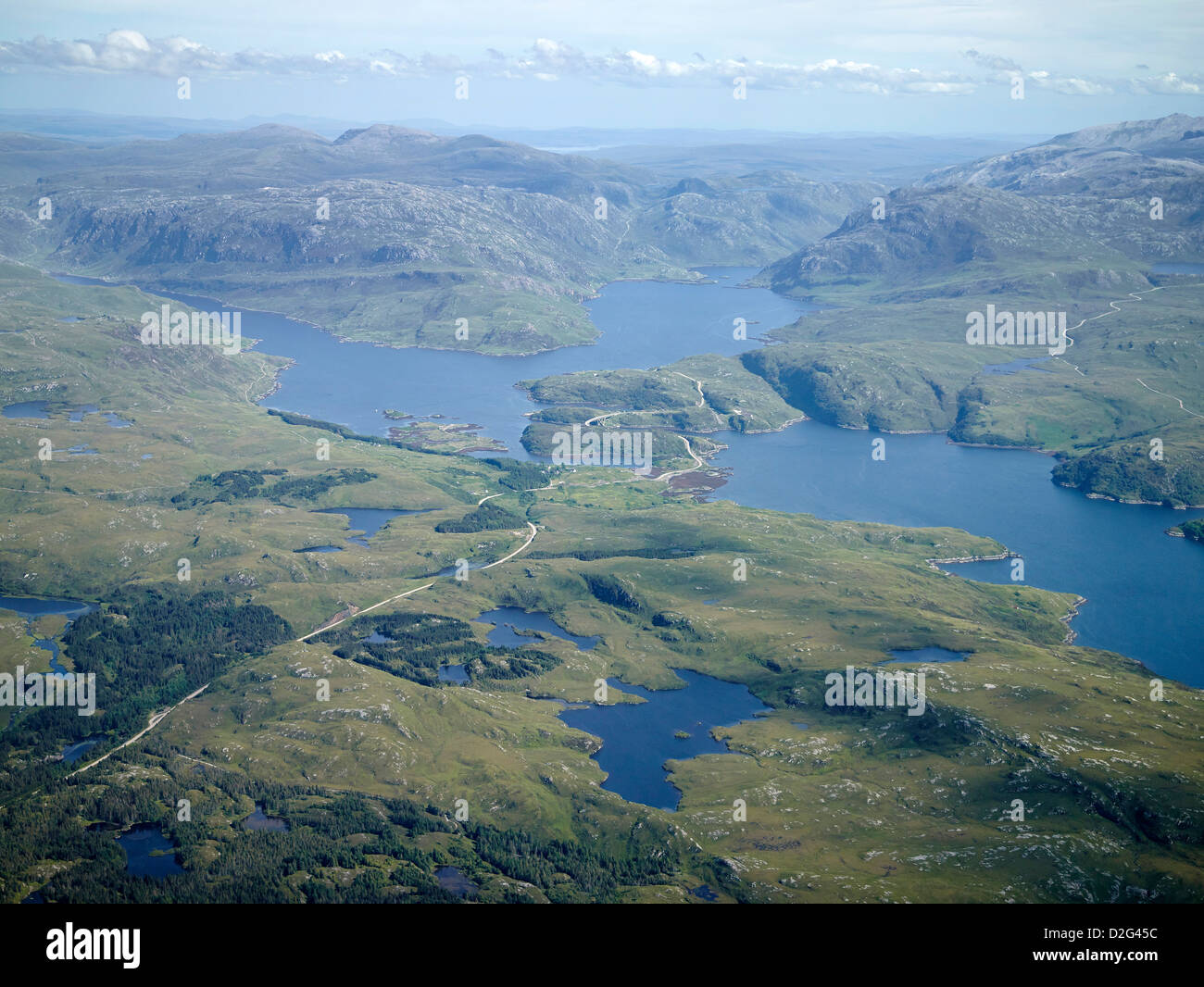 The A894 meandering through the wilds of Sutherland,The Kylesku Bridge crossing Loch a Chairn Bhain, Sutherland, - Stock Image