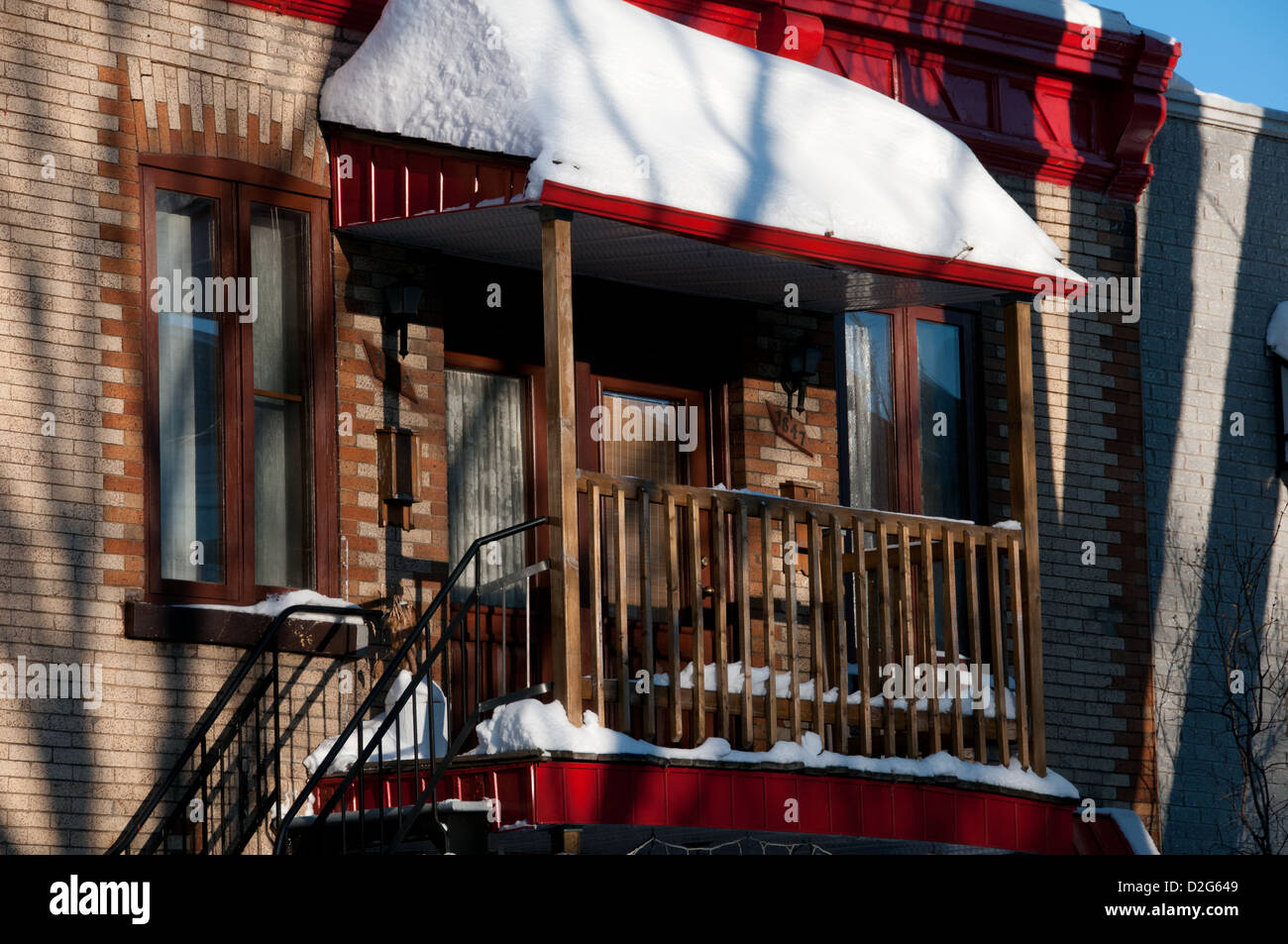 Balcony of a house covered in snow Montreal Canada - Stock Image