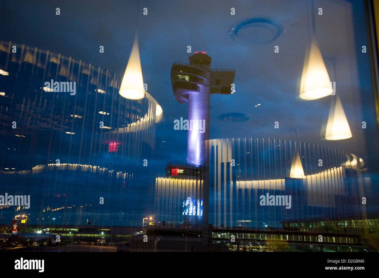 The Control Tower is floodlit at dusk at John F. Kennedy Airport, JFK Airport, New York, USA. Photographed with - Stock Image