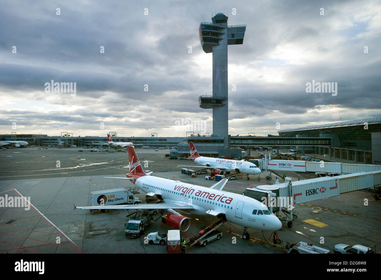 Two Virgin America Airbus A320 jet Aircraft stand in front of the Control Tower at John F. Kennedy Airport, JFK - Stock Image