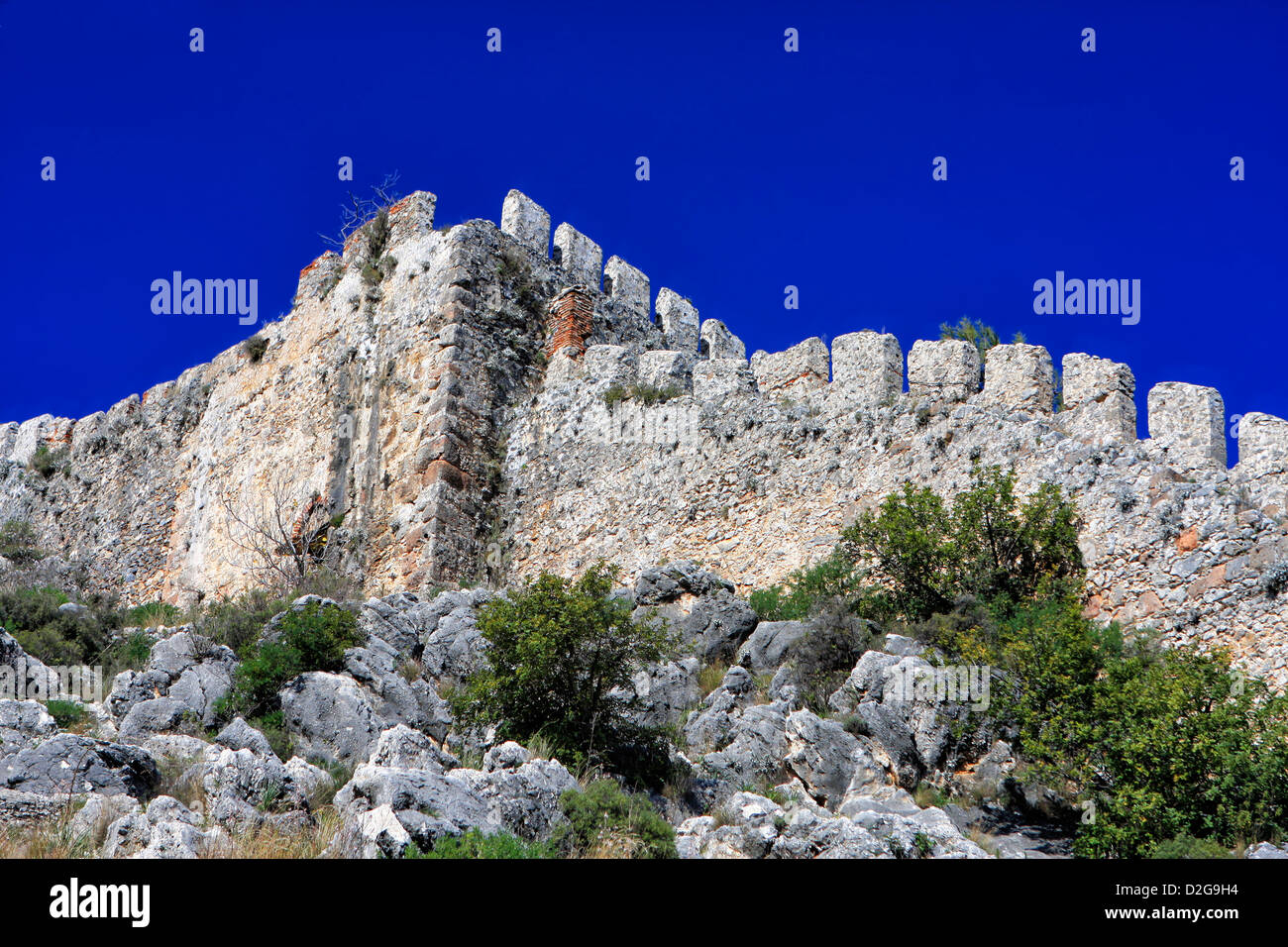 A double line of defensive walls munt the promontory to enclose the Citadel (Kale) inside which is a Byzantine Church. - Stock Image