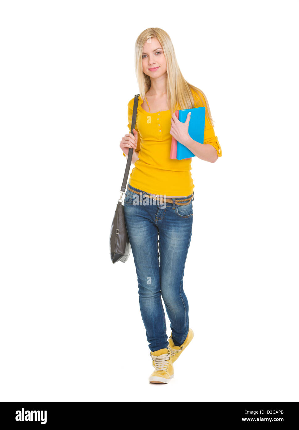 Teenage student girl with books going forward - Stock Image