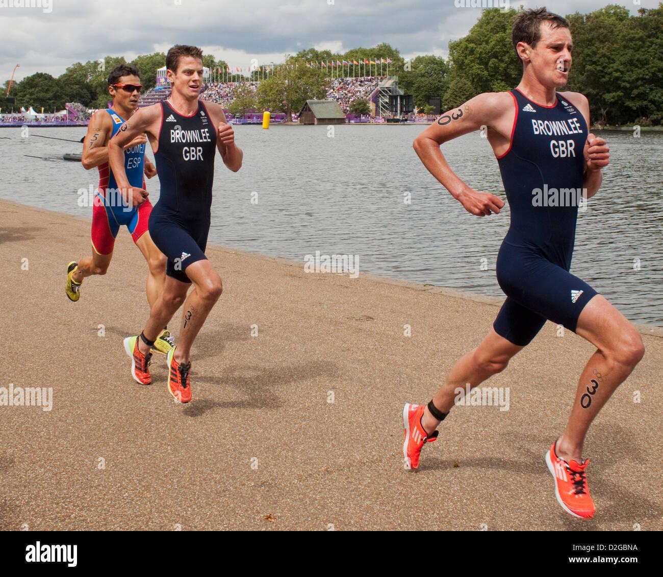 Alistair Brownlee, Jonathan Brownlee and Javier Gomez racing - 2012 London Olympics Men's Triathlon, Hyde Park - Stock Image