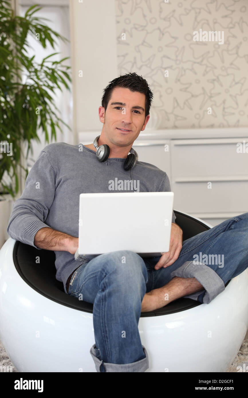 young man doing computer at home - Stock Image