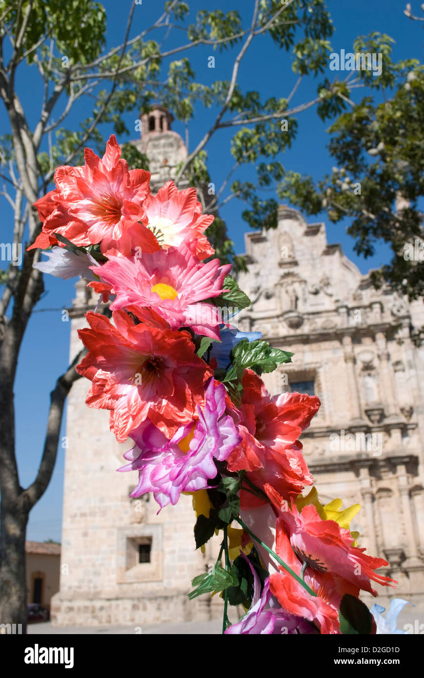 Imitation flowers on sale in a plaza in front of the Cathedral in Concordia,Sinaloa State, Mexico. - Stock Image