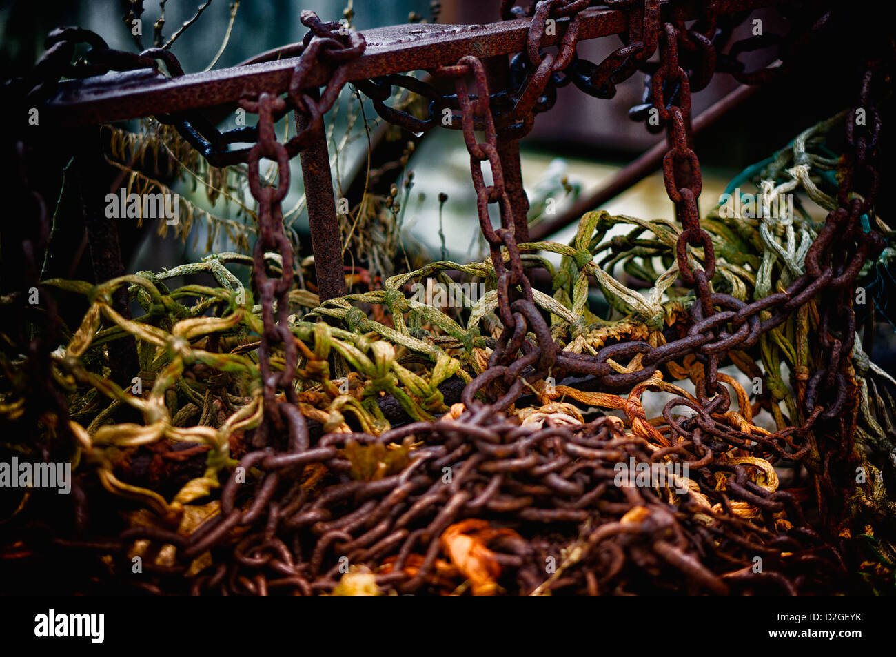 Piled fishing nets that have seen better days. - Stock Image
