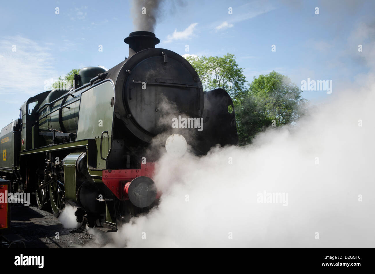Maunsell U Class steam engine at Bluebell Railway, Sheffield Park, near Uckfield, East Sussex - Stock Image