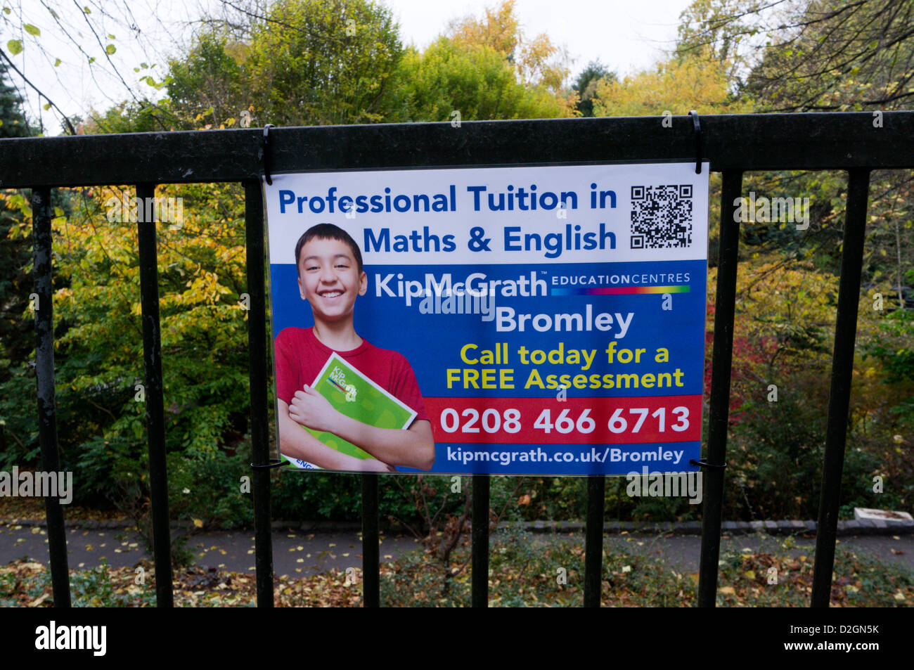 A sign for Kip McGrath Professional Tuition in Maths & English, containing a QR code which can be scanned for - Stock Image