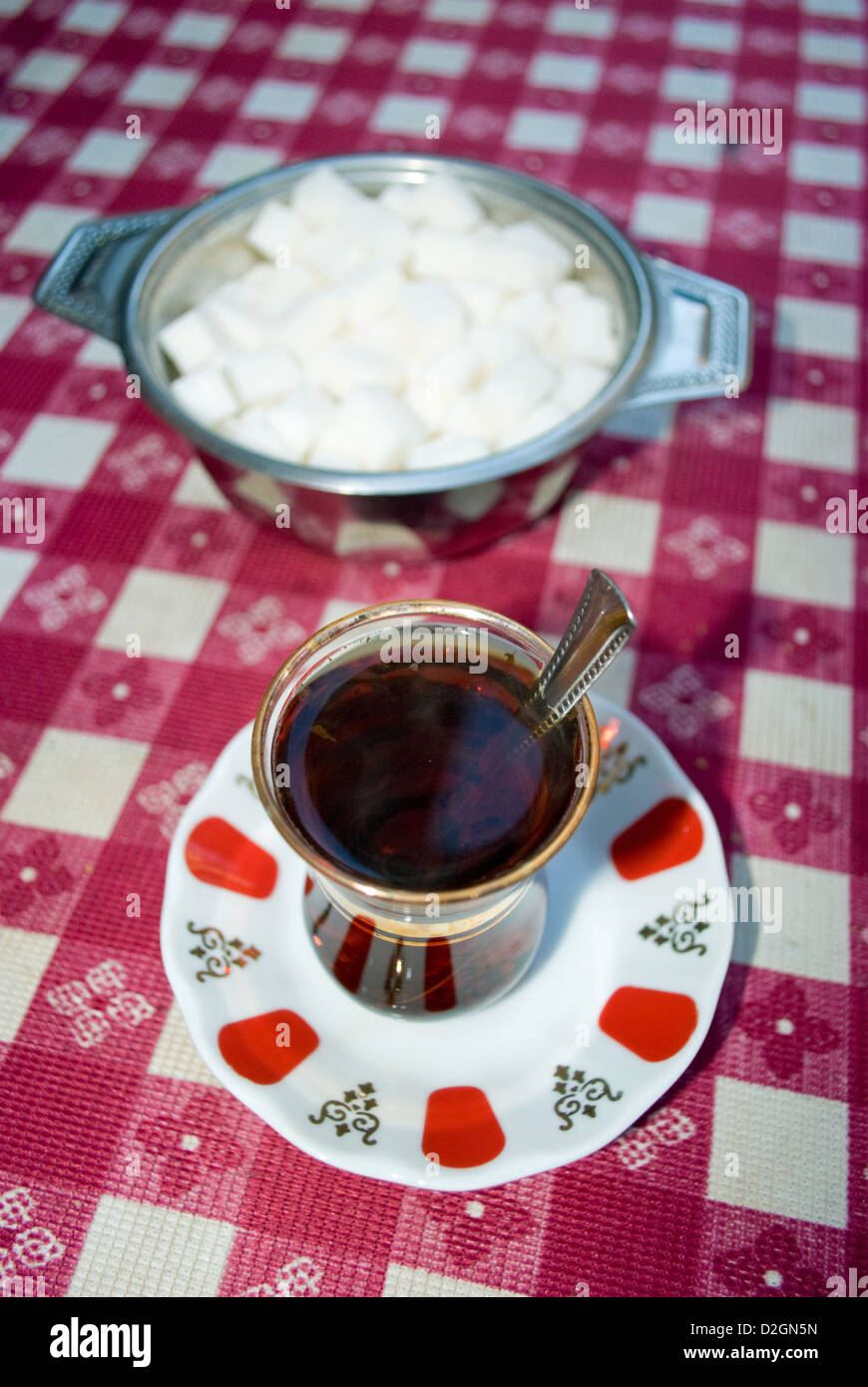 Turkish tea or çay, pronounced 'chai' traditionally served in a small tulip-shaped glasses without milk. Stock Photo