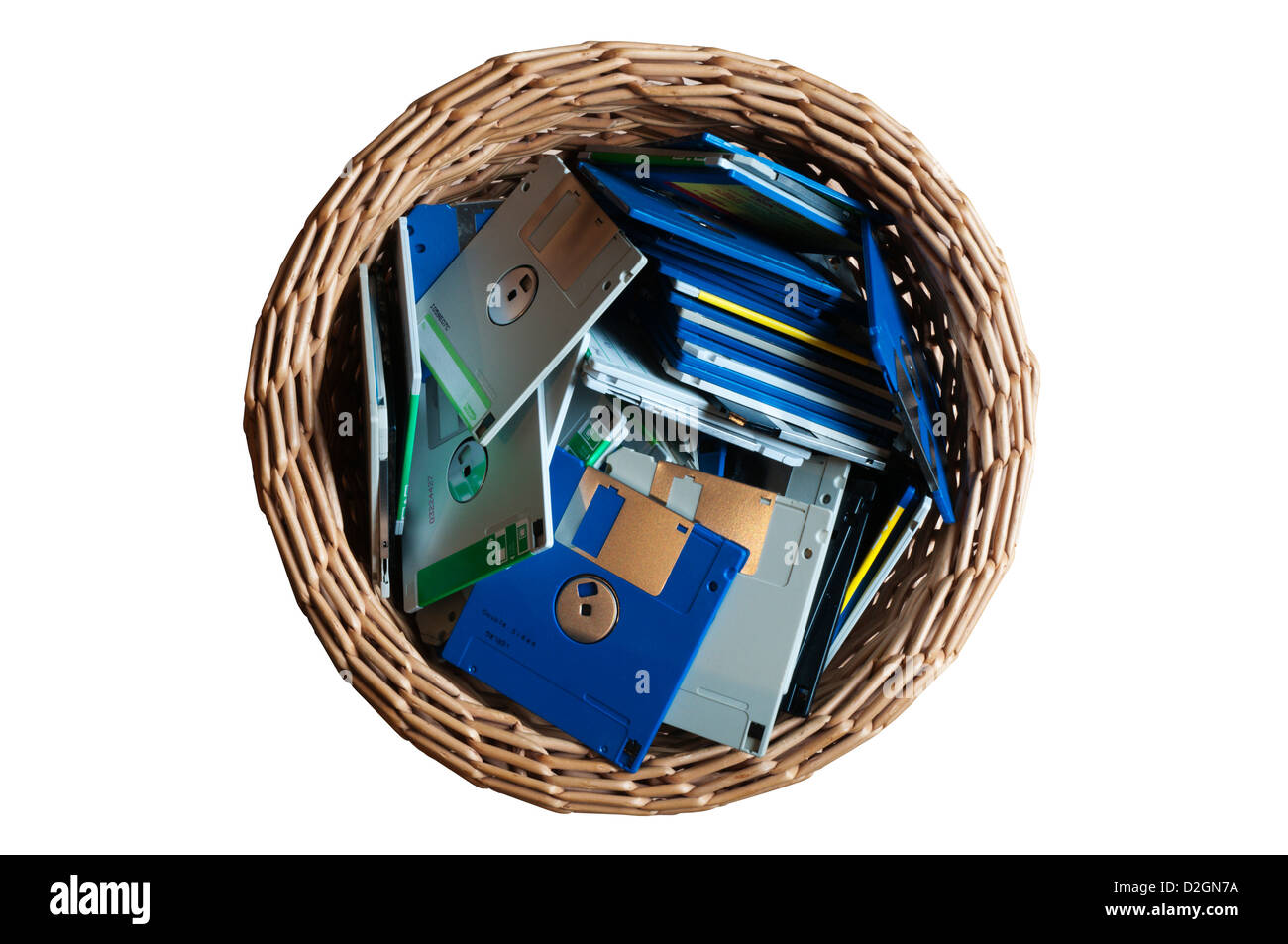 Old 3.5' computer disks thrown away in a waste paper basket. - Stock Image