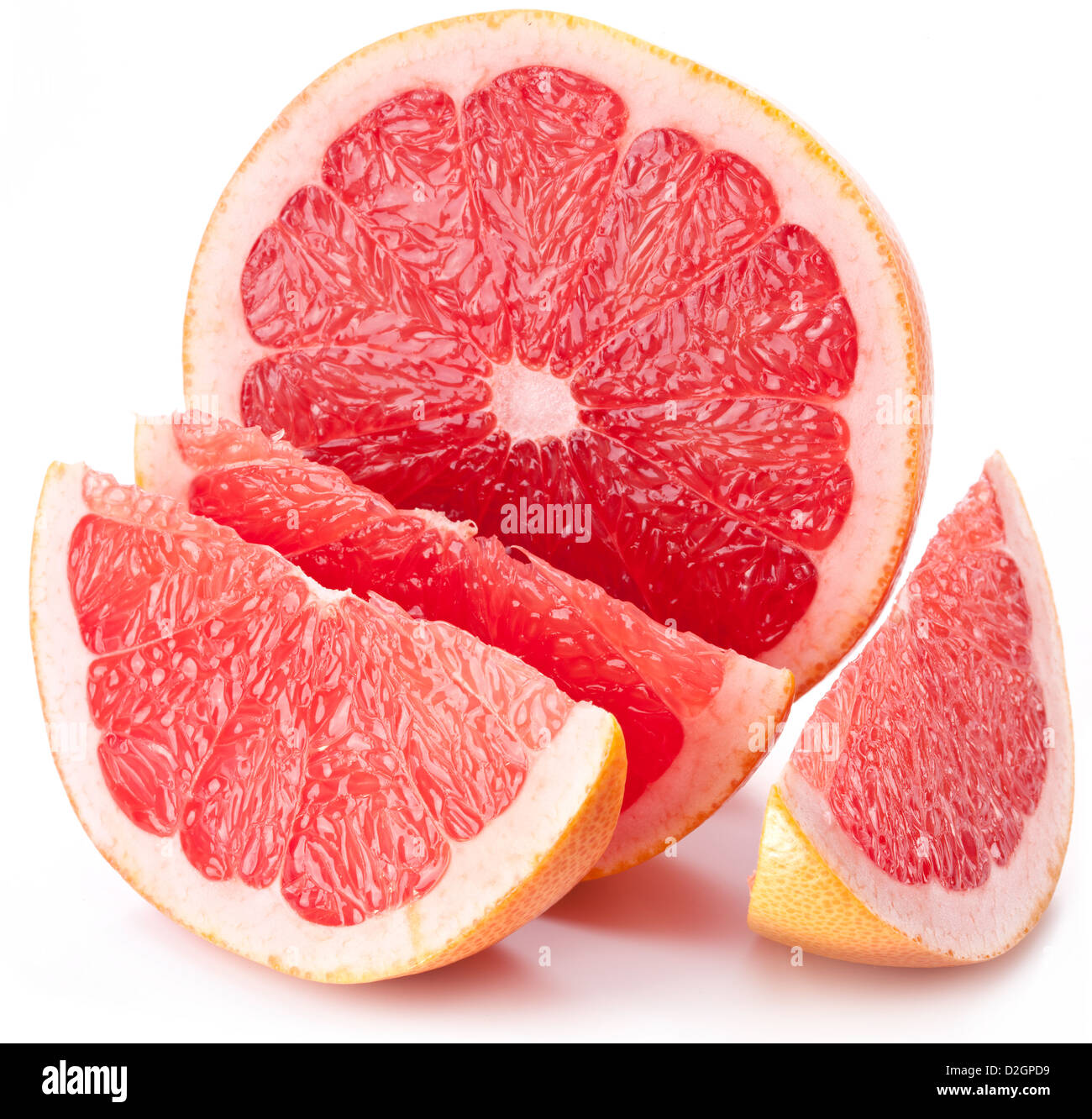 Grapefruit with slices on a white background. - Stock Image