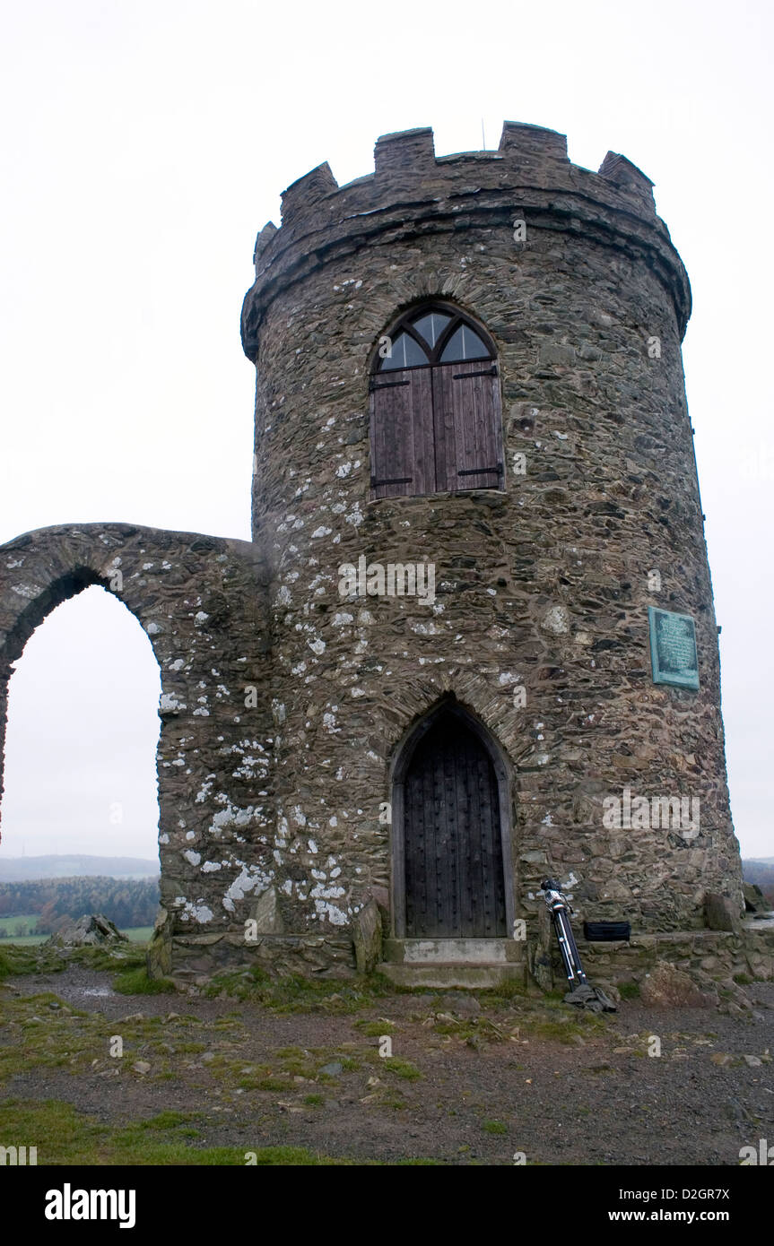 A stone tower siting in the middle of a hilly region within Leicestershire. - Stock Image