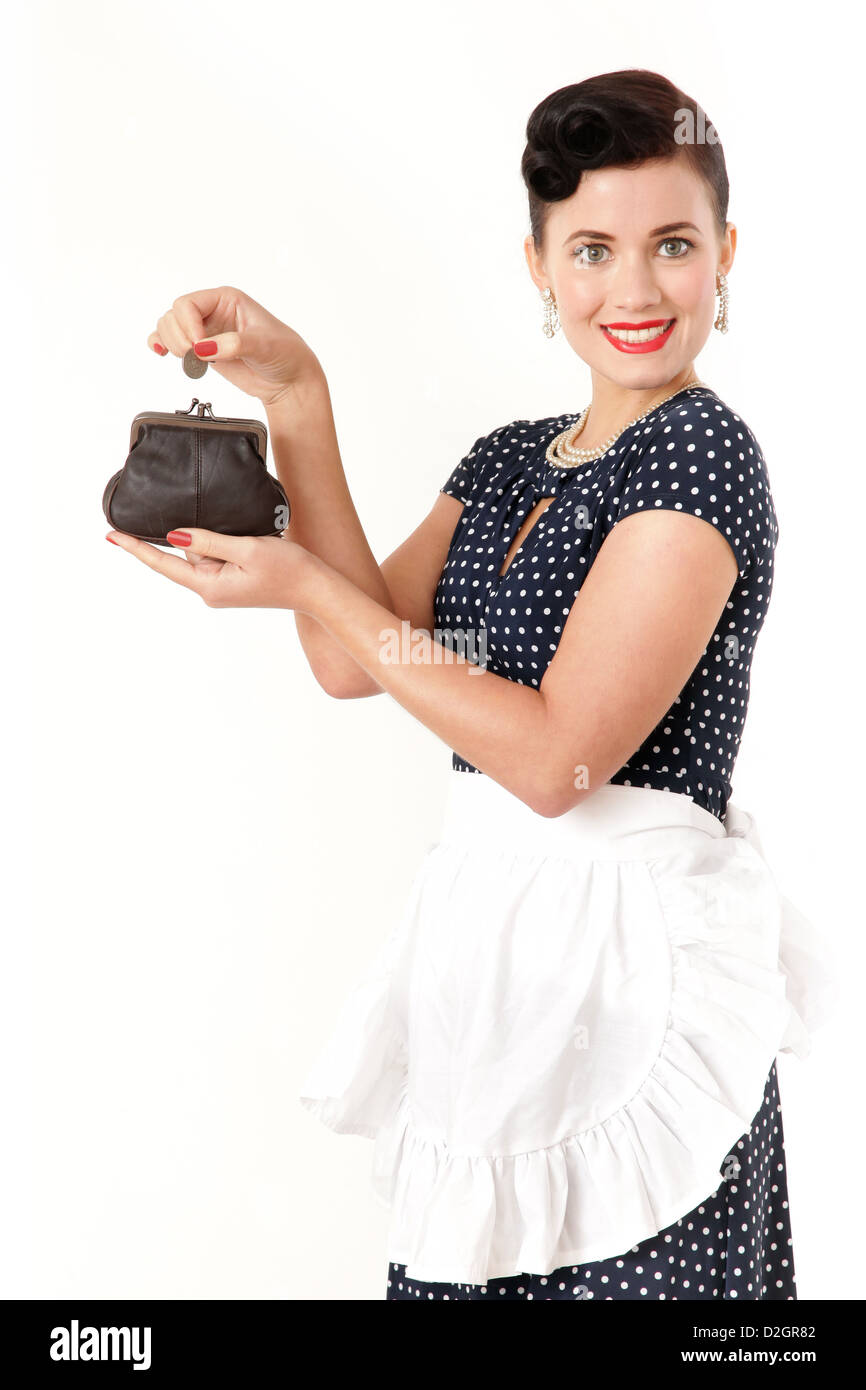 Woman putting money in a purse - Stock Image