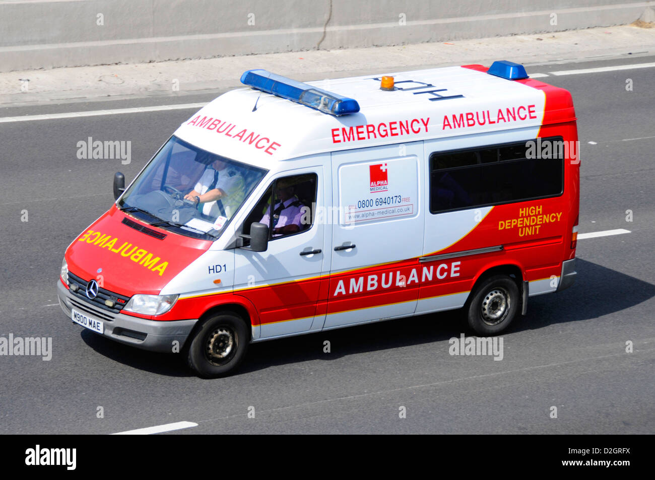 Looking down on emergency high dependency ambulance service vehicle operated by private company driving along M25 - Stock Image