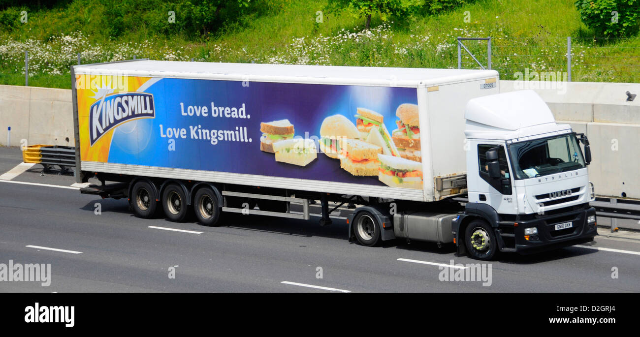 Advertisement on side of Kingsmill bread trailer behind an Iveco lorry on motorway (brand owned by Associated British - Stock Image