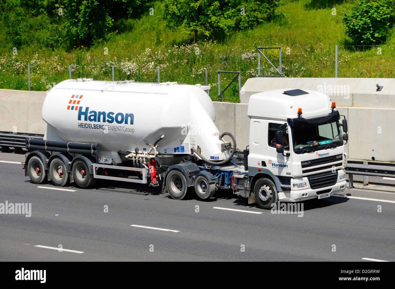 Hanson Heidelberg cement bulk tanker trailer and lorry with raised axle travelling on UK motorway - Stock Image