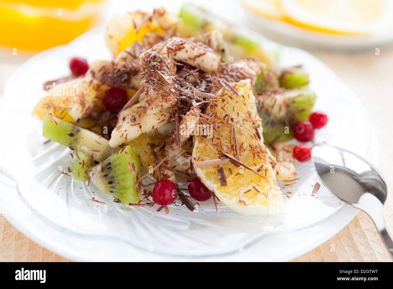 salad of kiwi and orange with chocolate, closeup - Stock Image