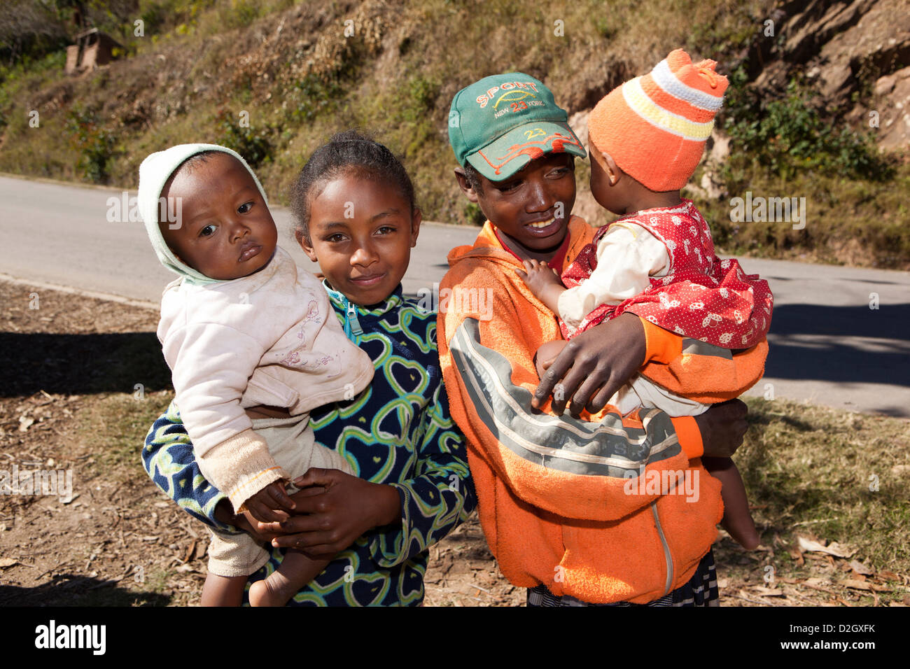 Madagascar, Ambohimahasoa, young Malagasy people with children - Stock Image