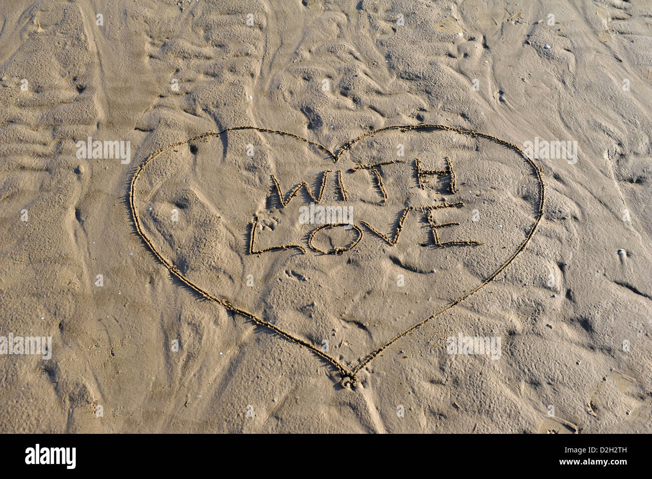 Word With Love written in sand - Stock Image