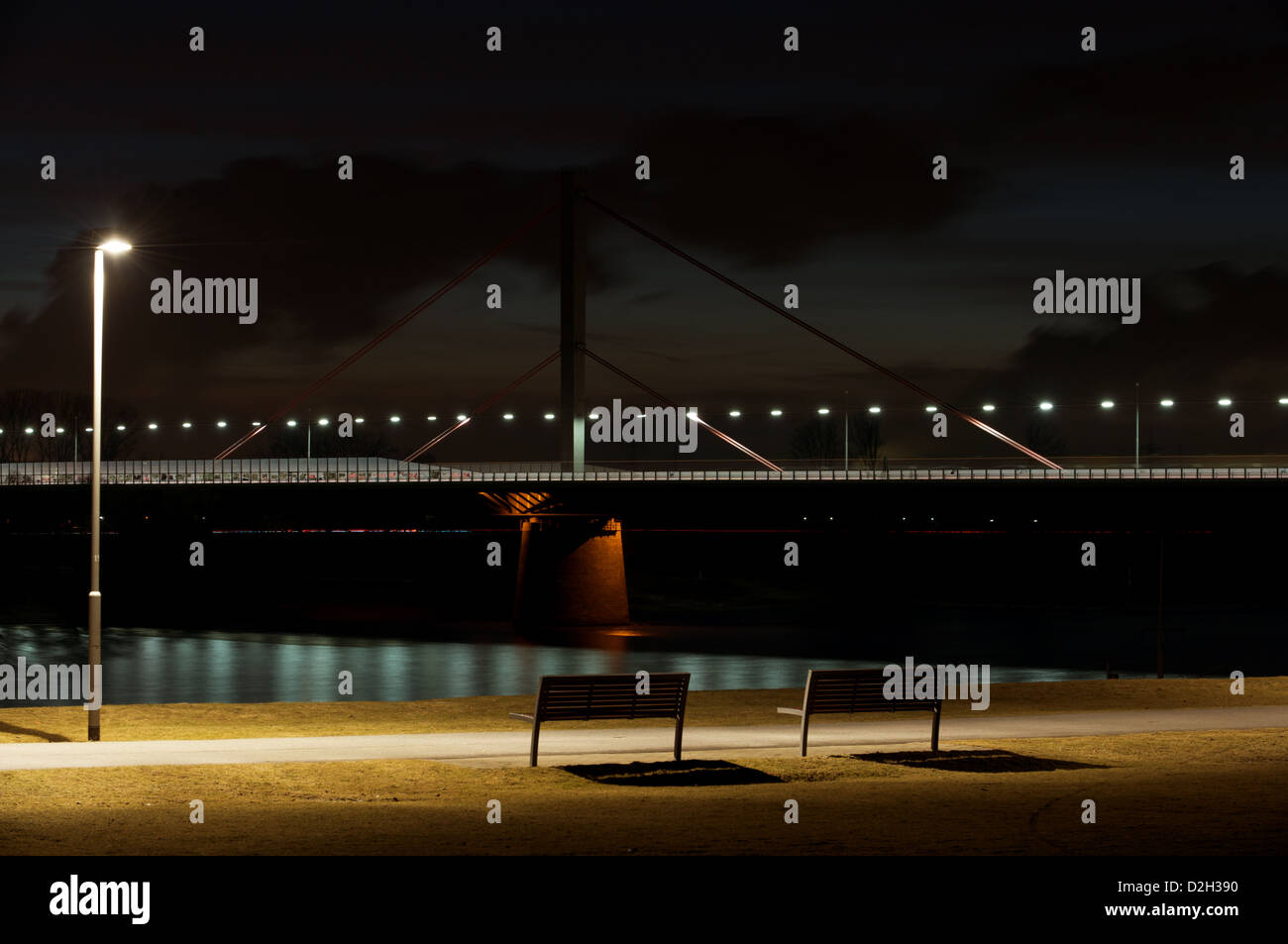 Motorway bridge over the river Rhine at night, Leverkusen, Germany. Stock Photo