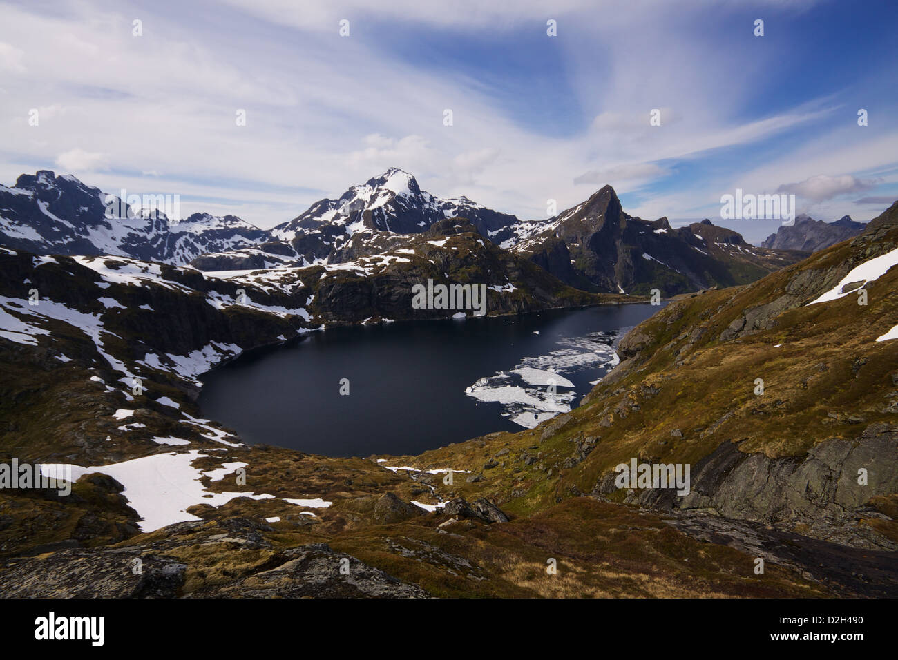 Scenic panorama with frozen fjord and mountain peaks in Norway - Stock Image
