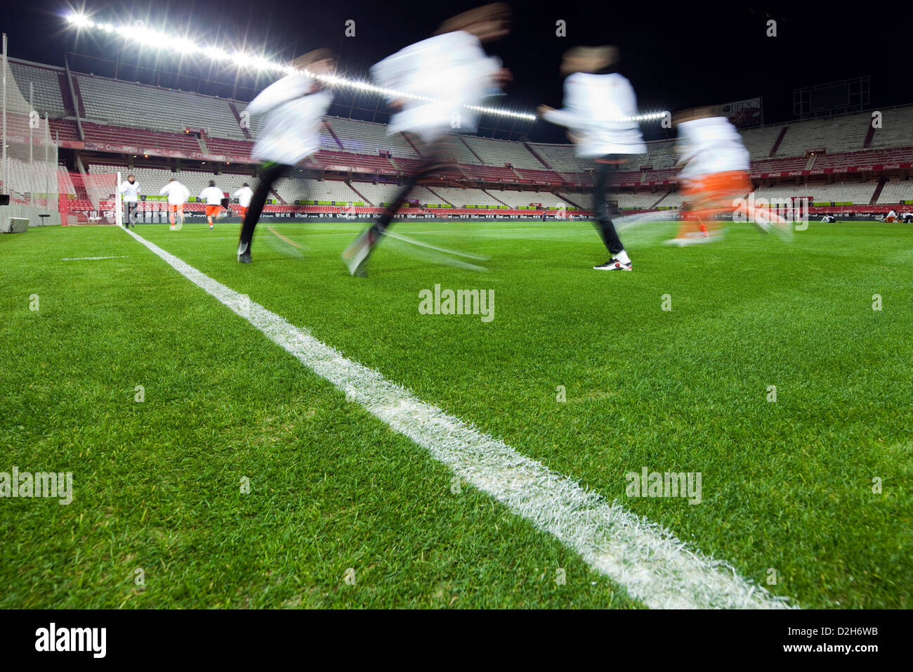 Seville, Spain, football players in a pub in the evening - Stock Image