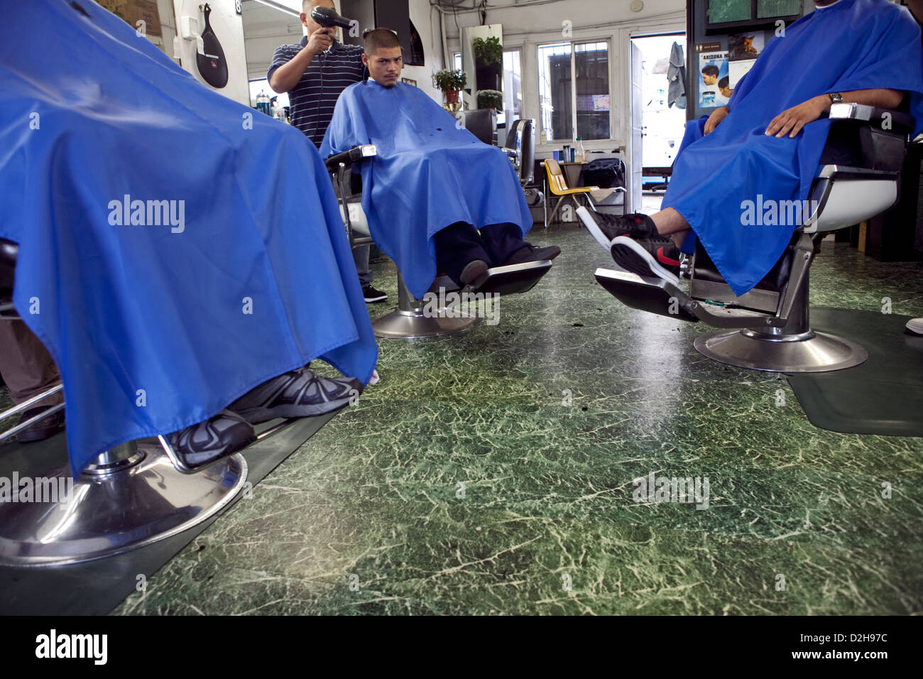 young hispanic locals getting haircuts at Oaxaca barber shop ON La Cienega Blvd  in Los Angeles, USA Stock Photo