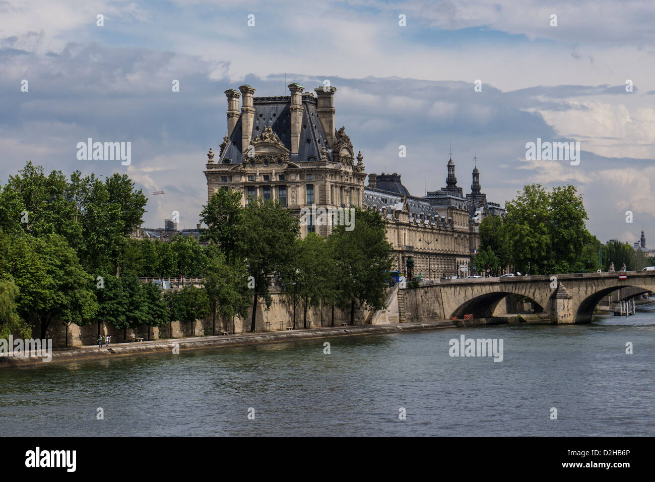 The Louvre Museum in Paris France viewed from the Seine river - Stock Image