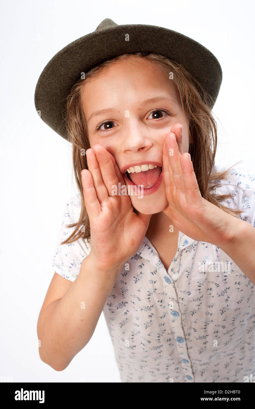 Berlin, Germany, a girl with a Tyrolean hat cries loudly - Stock Image