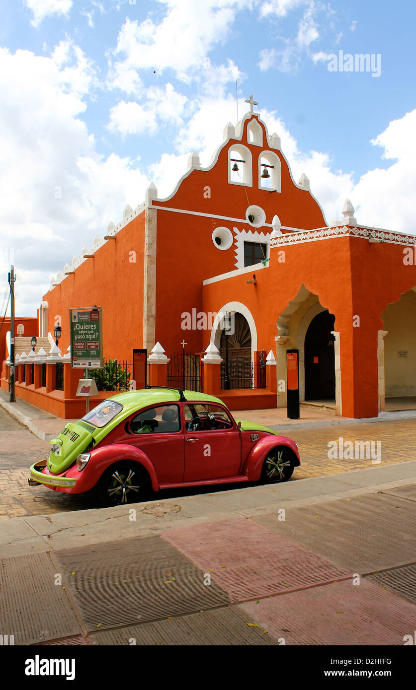 Old fashioned Volkswagen in front of a church in Valladolid, Mexico - Stock Image