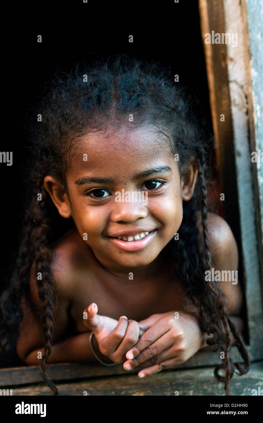 toddler in village house, hell-ville, nosy-be, madagascar - Stock Image