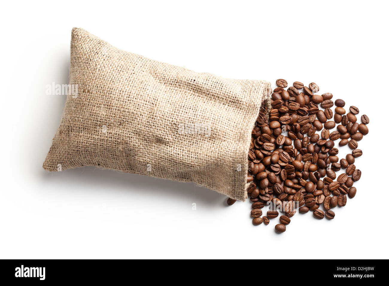 coffee beans in jute bag on white background - Stock Image