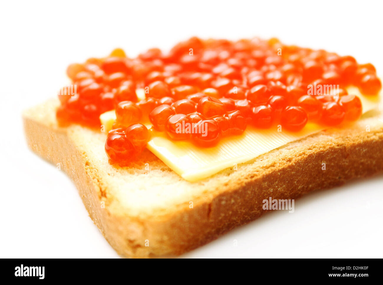 Closeup of red caviar sandwich on white background - Stock Image