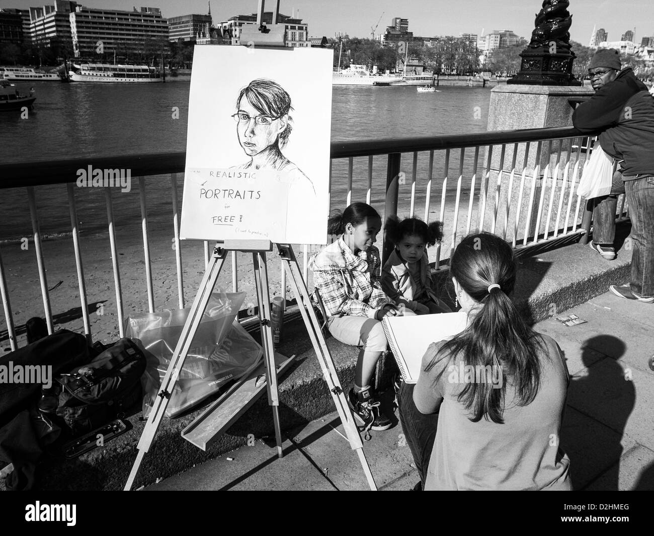 street painter in sunny day on Thames bank near National Theater in London - Stock Image