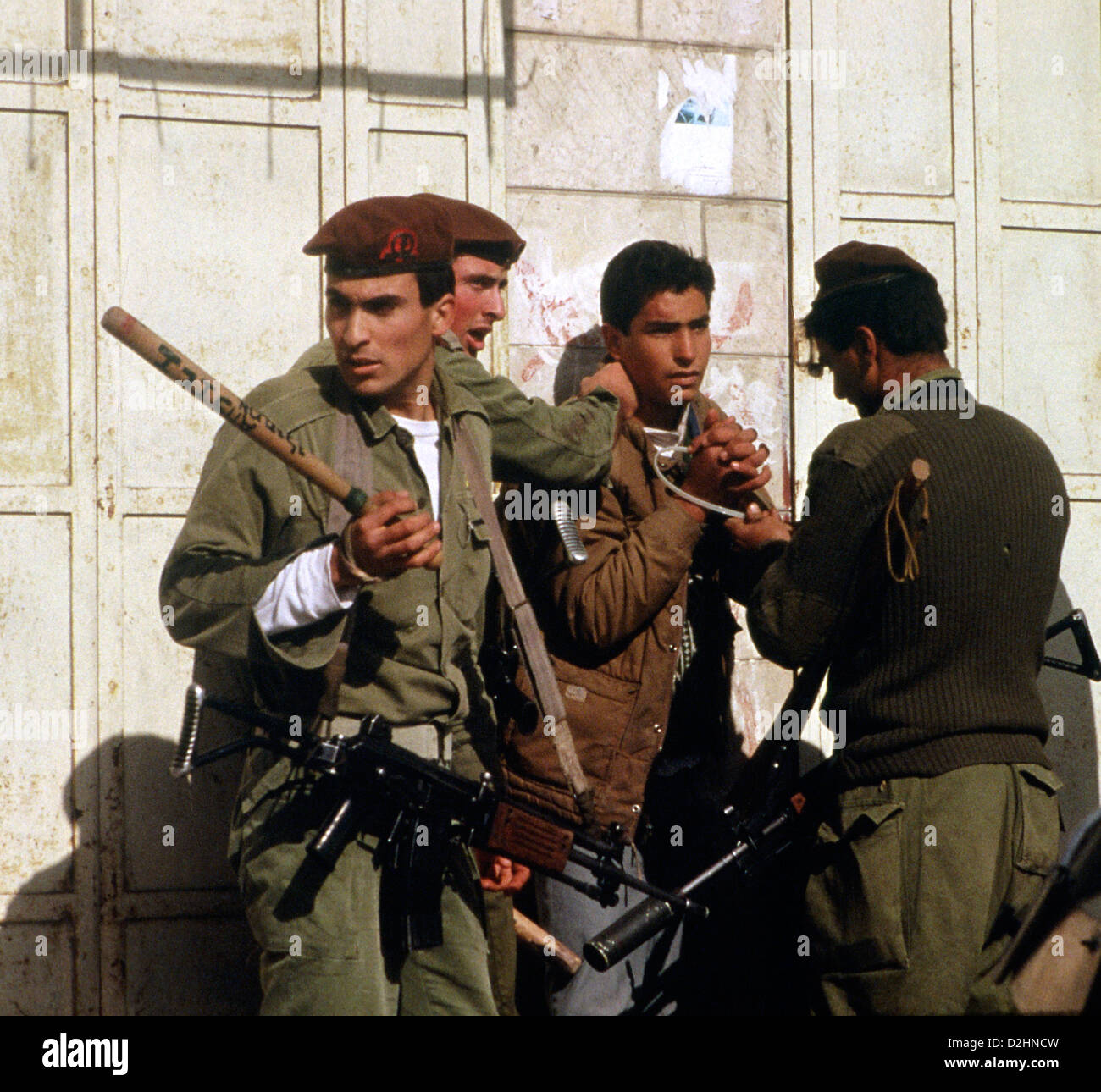 Palestinian youth being arrested in the West Bank town of Ramallah by the Israeli Defense Force at the start of - Stock Image