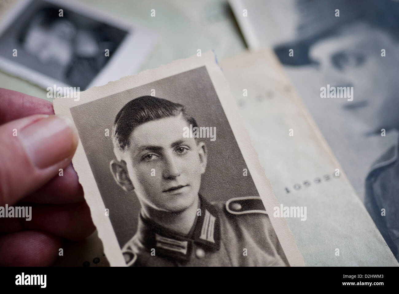A staff member of the German tracing serivce holds a portrait picture of a missing German soldier from the Second - Stock Image