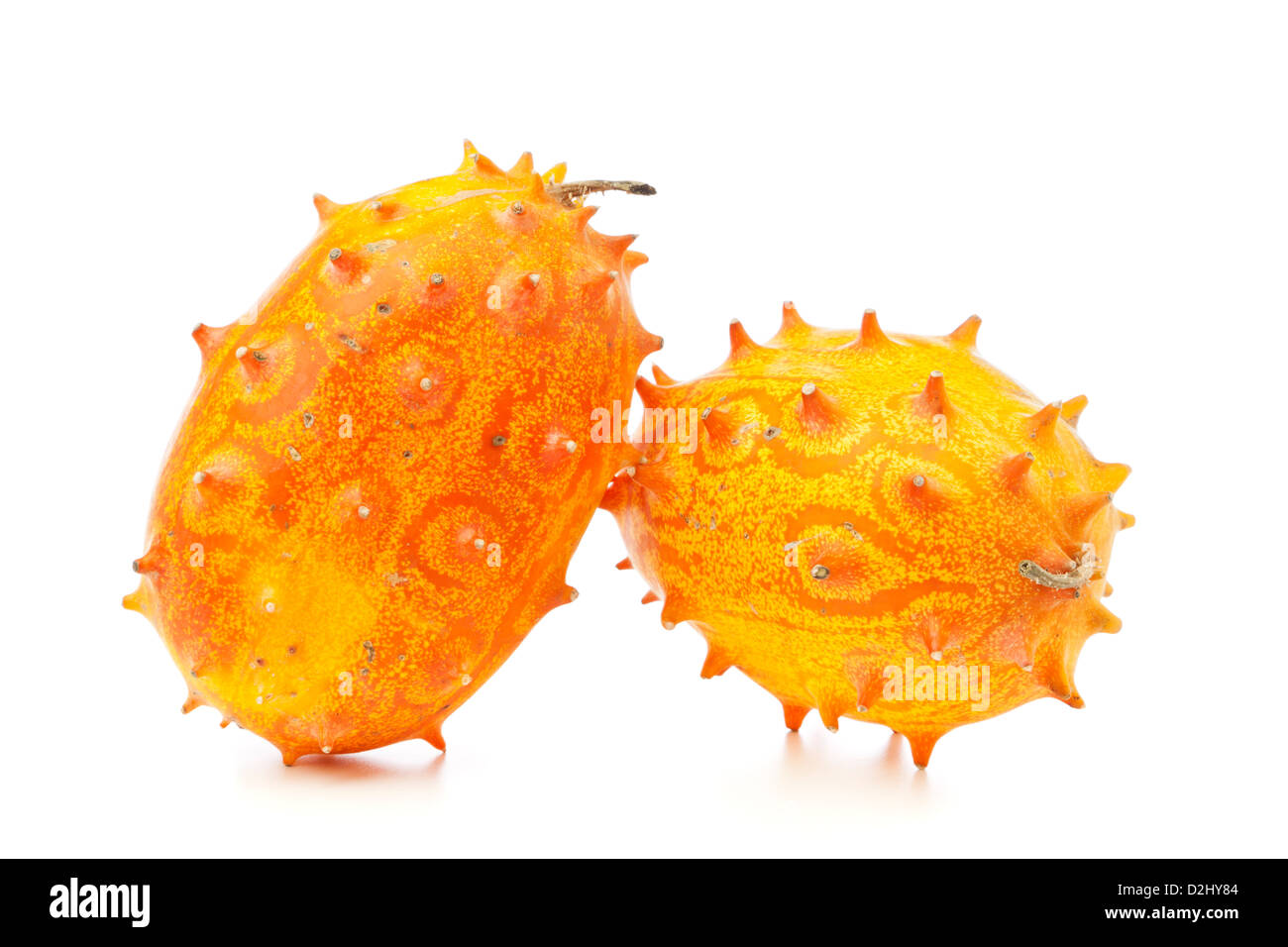 Two Kiwano fruit, also called African Horned melon or Horned Cucumber, isolated on white background Stock Photo