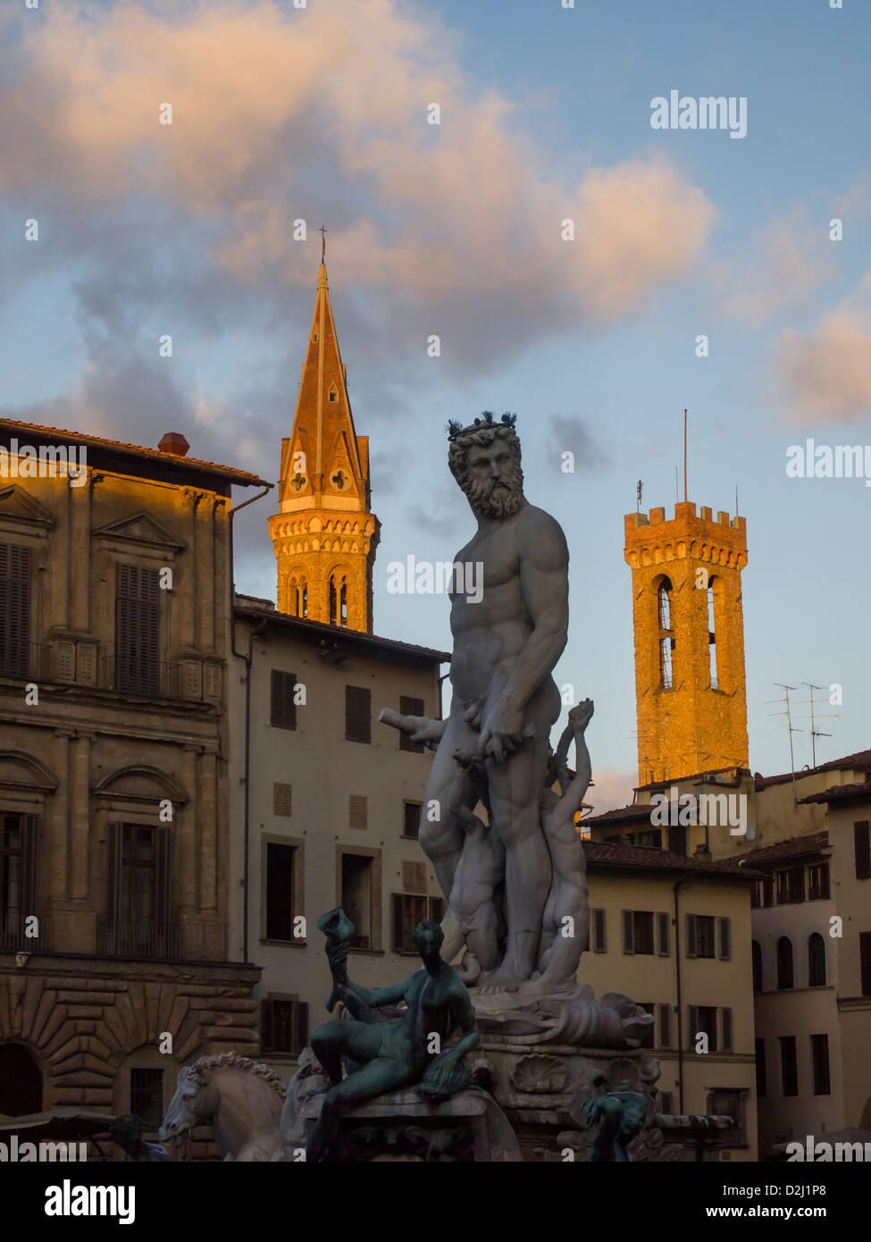 Italy,Tuscany,Florence, Neptune fountain and Badia Fiorentina bell tower,Signoria square. Stock Photo