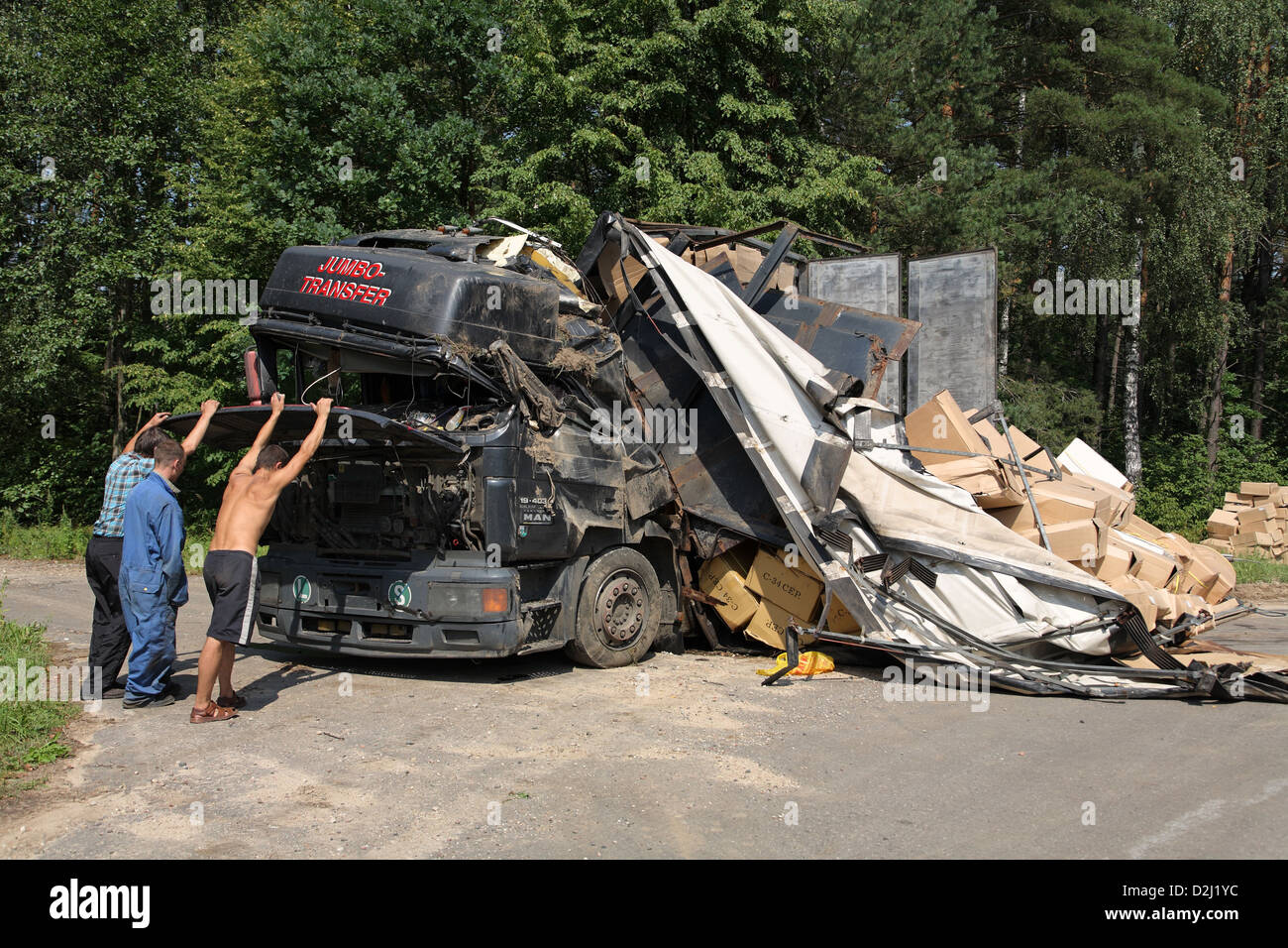 Hrodna, Belarus, men examine state of the engine of a truck wreck