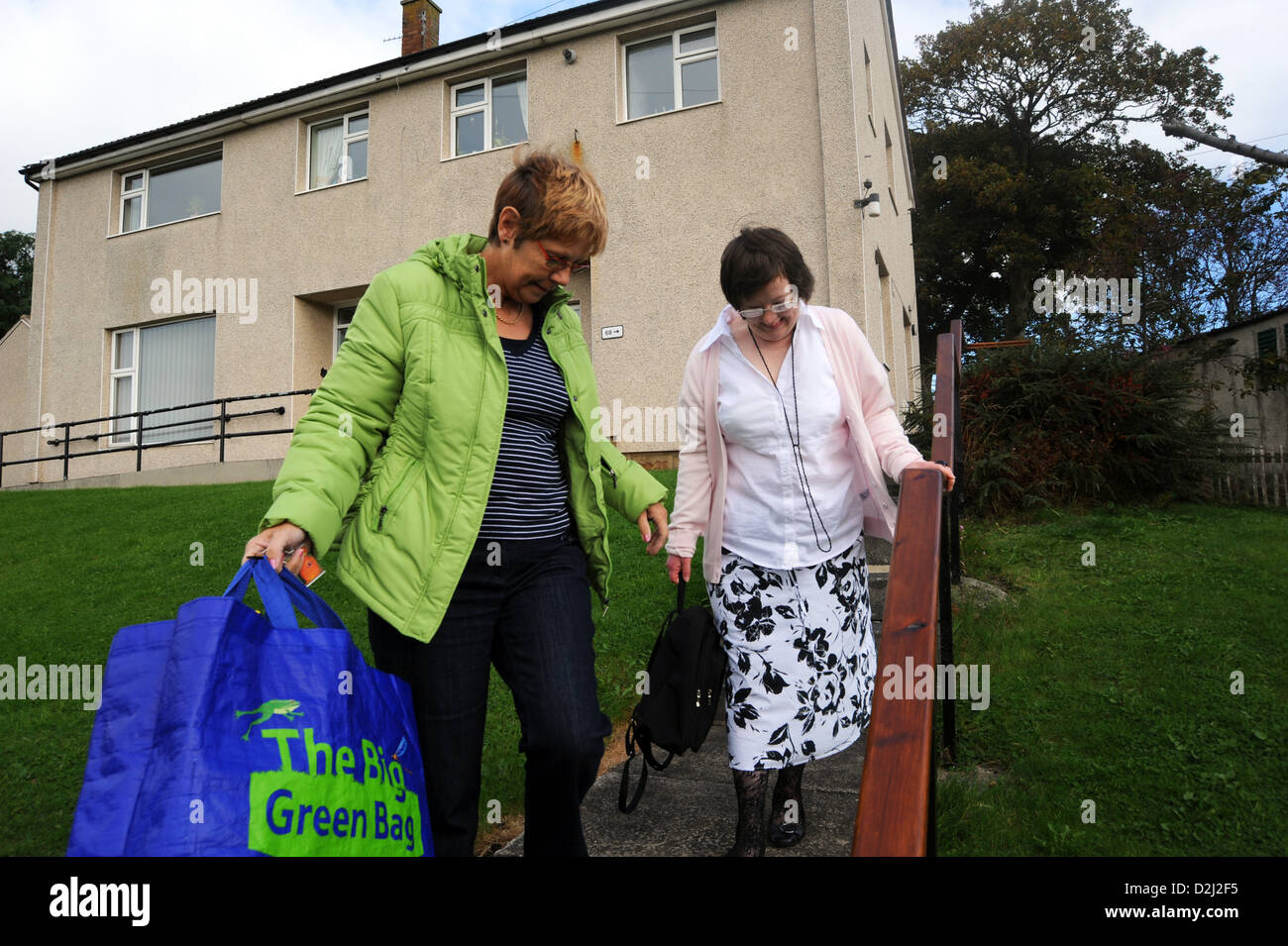 A Young disabled women lives independently with help from her carer, she goes shopping. - Stock Image