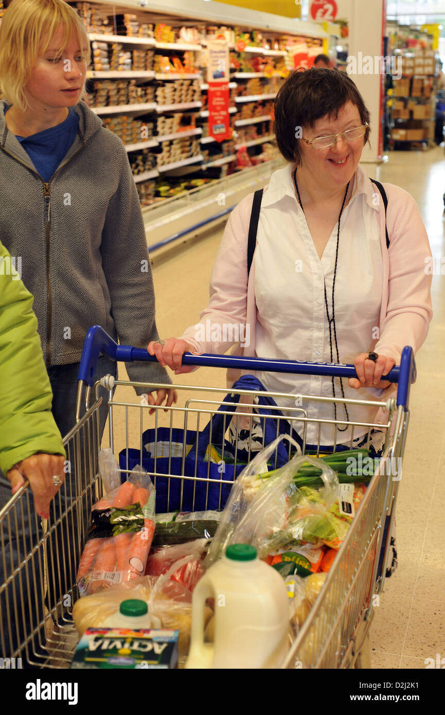 Two young women with Learning Disabilities go shopping with their support worker, Skipton, North Yorkshire. Stock Photo