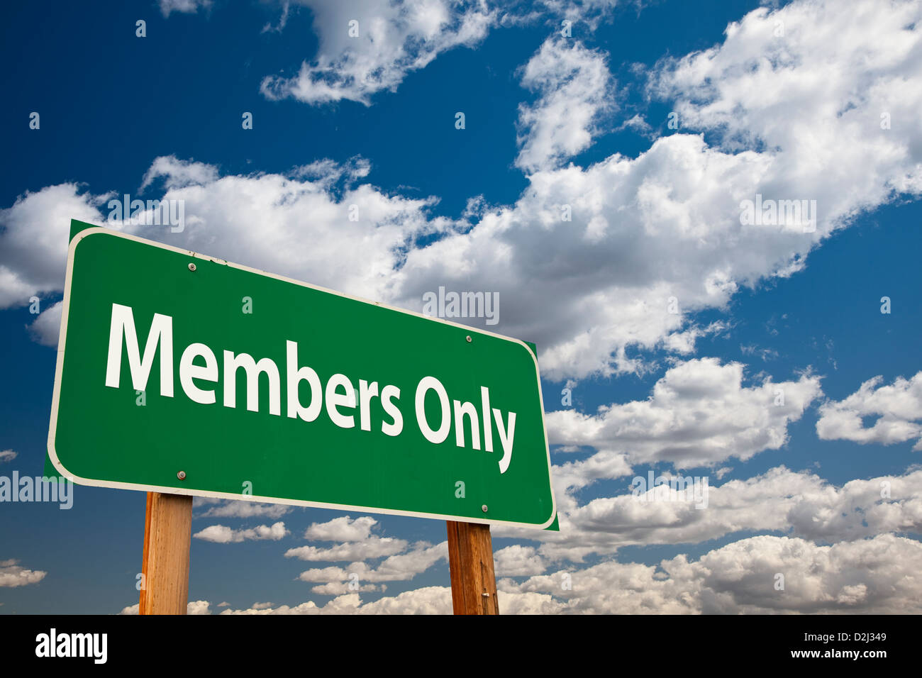Members Only Green Road Sign Over Clouds and Sky. - Stock Image