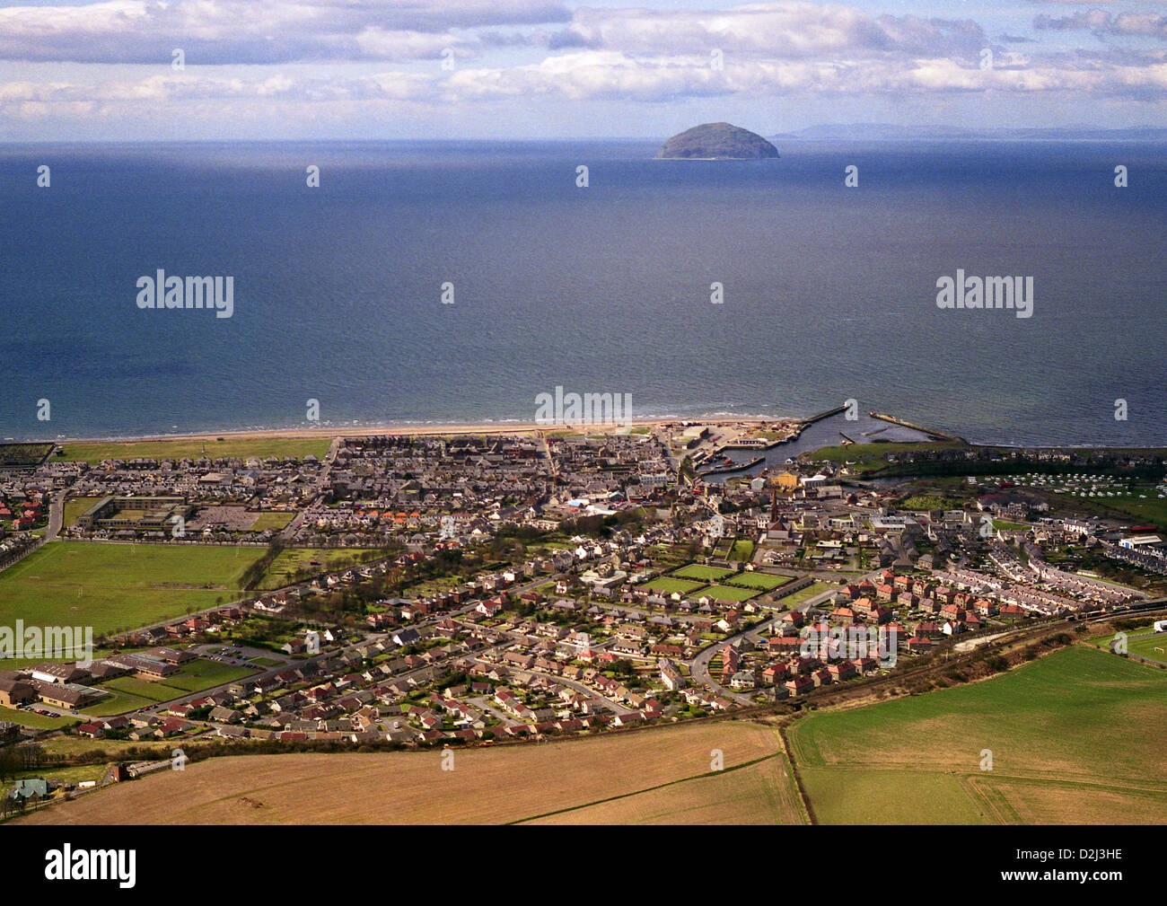 Aerial view of Scottish town of Girvan with the island of Ailsa Craig in the distance - Stock Image