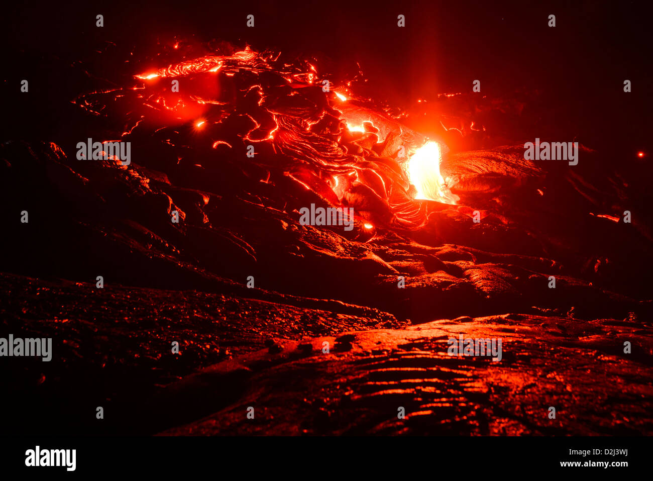 Lava flowing from a vent in Kilauea Volcano, Big Island, Hawaii - Stock Image
