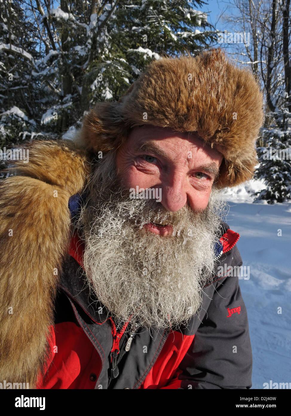 The musher for the 'Fun Dog' husky sleigh ride company. Zakopane, Poland. - Stock Image